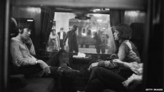 Paul McCartney and Mick Jagger in a first-class carriage 1967