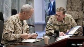 General John Allen and General David Petraeus, attend a meeting in Kabul, Afghanistan 9 July 2011