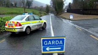 Irish police car on rural road
