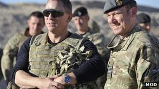 Daniel Craig (l) at Camp Bastion