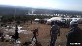 Syrian refugees are seen in a refugee camp on the Syrian side of the border with Turkey, near Idlib, on 15 November 2012