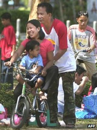 A Filipino family in a park