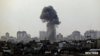 Smoke rising after an Israeli air strike in Gaza