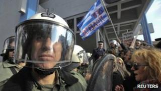 Anti austerity protesters argue with police in Thessaloniki