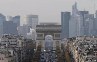 The skyline of the Defense business district is seen behind the Arc de Triomphe in Paris, 20 November