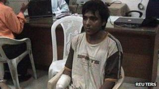 Mohammed Ajmal Kasab, the lone surviving suspected gunman in the 2008 Mumbai attacks, is seen under police custody at an undisclosed location, in this undated still file image taken from video footage shown on the CNN-IBN television channel since February 3, 2009
