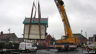 Sheringham signal box lifted by crane