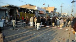 Residents at the site of the blast in Rawalpindi on 22 November 2012