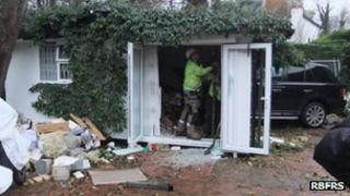 Range Rover crashed into house