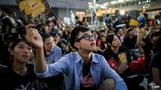 A student holds a leaflet during a protest asking for the complete withdrawal of the government's plans to implement Chinese patriotism classes in Hong Kong on October 17, 2012.
