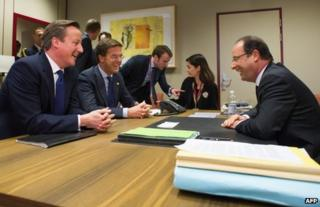 French President Francois Hollande (R) chats with UK Prime Minister David Cameron (L) and Dutch Prime Minister Mark Rutte at the EU Headquarters, 23 November
