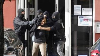 Izaskun Lesaka, centre, surrounded by French Police officers, screams as she leaves the hotel where she was arrested with another suspected member of Eta