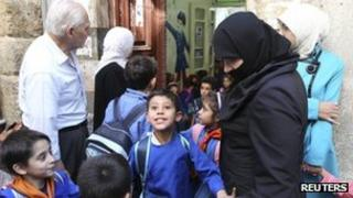 Children leave school as parents wait outside in Damascus, Syria. Photo: November 2012