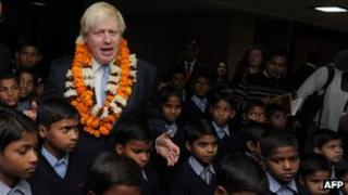 Mr Johnson with schoolchildren at Amity University
