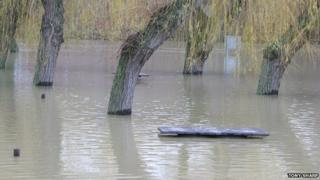 Picnic benches under flood water at the Embankment in Wellingborough