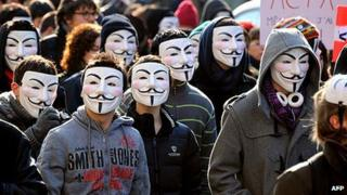Demonstrators wearing Anonymous Guy Fawkes masks during a protest