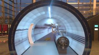 The replica of a section of the Large Hadron Collider on show in the Senedd