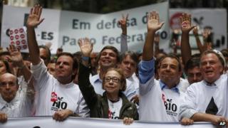 Rio de Janeiro's Governor Sergio Cabral, second from right, Brazilian actress Fernanda Montenegro, centre, and Rio de Janeiro's Mayor Eduardo Paes, second from left, lead a march in Rio de Janeiro