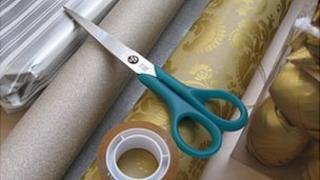 Christmas wrapping paper, scissors and sticky tape