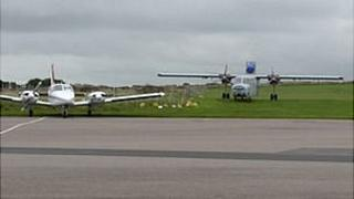 Alderney Airport: planes parked on grass