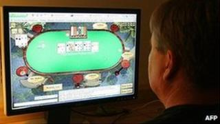 File picture showing a man playing poker on his computer connected to an internet gaming site from his home in Manassas, Virginia 2 October 2006