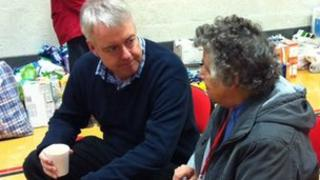 First Minister Carwyn Jones talks to a victim of the floods in St Asaph