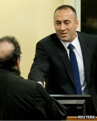 Ramush Haradinaj (R) shakes hands with an unidentified lawyer before the verdict reading in his retrial at the International Criminal Tribunal for the former Yugoslavia in The Hague, 29 November 2012