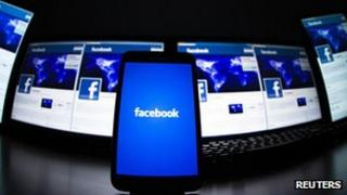 Facebook logo on mobile and computer