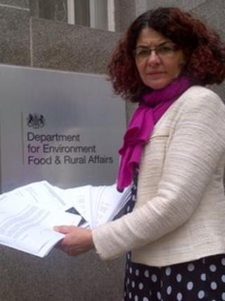 Diana Johnson holding letters in her hands in front of Defra building