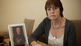 Jane Bennett with a photo of her son Scott
