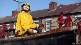 A giant Marionette is towed through Liverpool