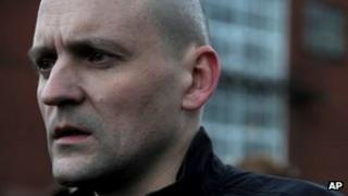 Sergei Udaltsov emerges from the Investigative Committee building in Moscow after being charged, 26 October