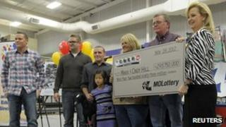 Mark and Cindy Hill claim their share of the Powerball jackpot in Dearborn, Missouri 30 November 2012