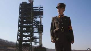 n this April 8, 2012 file photo, a North Korean soldier stands in front of the country's Unha-3 rocket, slated for liftoff between April 12-16, at Sohae Satellite Station in Tongchang-ri, North Korea