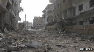 "A view of buildings damaged by what activists said were missiles fired by a Syrian Air Force fighter jet loyal to Syria""s President Bashar al-Assad in Daria, near Damascus, 30 November 2012"