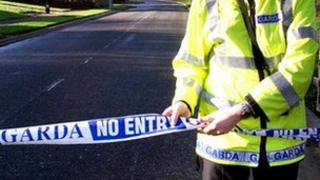 Irish policeman closes road