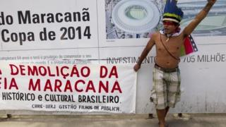An indigenous Brazilian takes part in a protest against the privatisation of the Maracana stadium, 1 December