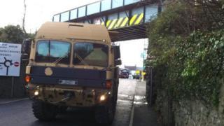 Vehicle next to bridge