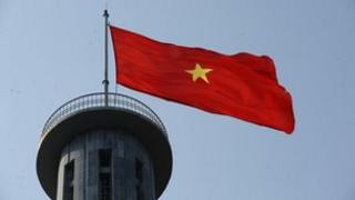 A Vietnamese flag flying at a tower near the country's border with China in Dong Van district, Ha Giang province, 8 March 2012