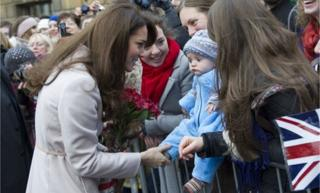 The Duchess of Cambridge talks to a baby fan