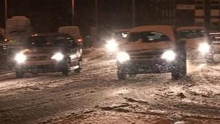 Cars driving through snow in Luton