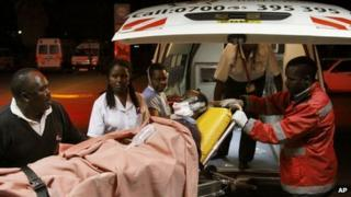Paramedics treat a wounded person after a blast in Kenya's capital Nairobi on 5 December 2012