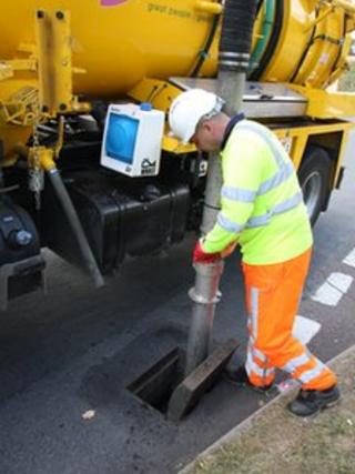 A man cleaning a drain in Northamptonshire