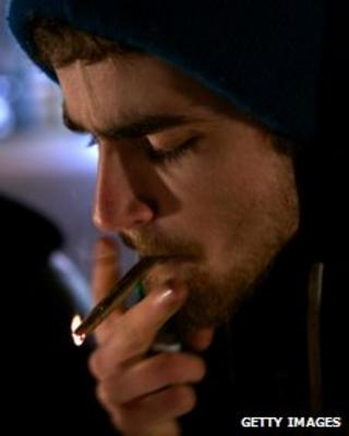 A man smokes marijuana in Seattle shortly after a law legalising its recreational took effect in Washington state on 6 December 2012