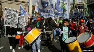 Activists play drums during an anti-government demonstration called by the Argentine Workers Confederation