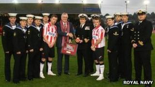 HMS Defender crew and Exeter City players meet. Pic: Royal Navy