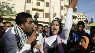 Egyptian protesters chant anti Muslim Brotherhood slogans outside the presidential palace in Cairo, Egypt, Thursday, Dec. 6, 2012