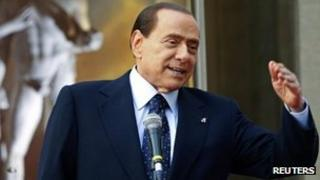 "Then Italian Prime Minister Silvio Berlusconi speaks during the ""Campus Mentis"" award ceremony in Rome April 8, 2011"