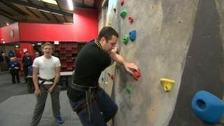 Young people on a climbing wall