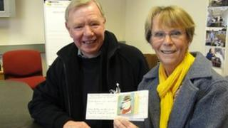 Joyce Lampitt and brother Ken Payne with the Christmas card they have been exchanging for more the 40 years